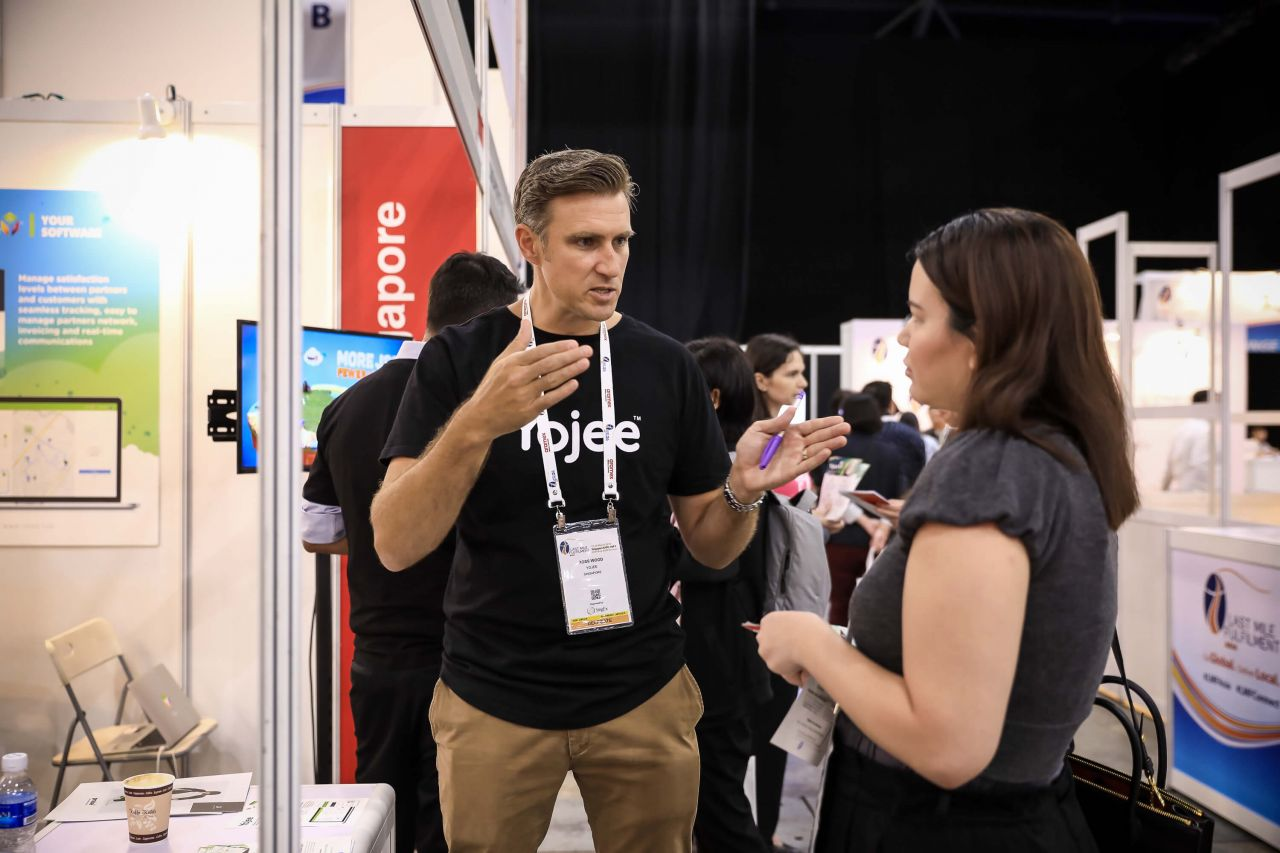 Ross Wood, Director of Business Development - Yojee in discussion with an attendee about the Logistics & Supply Chain
